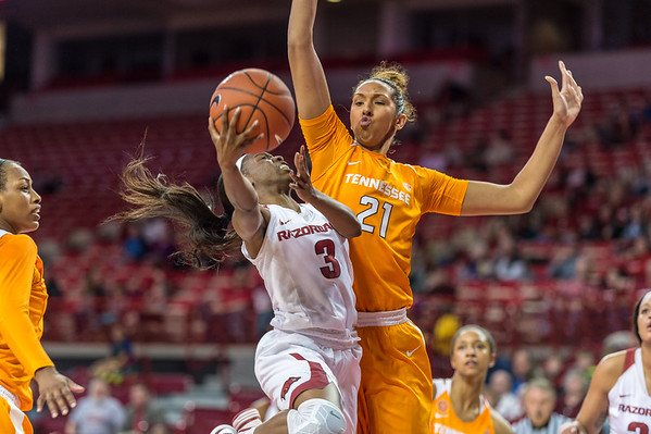 Arkansas Lady Razorbacks guard Malica Monk (3) is guarded by Tennessee Lady Volunteers center Mercedes Russell (21) on a shot during a basketball game between Arkansas and Tennessee on January 14, 2016.    (Alan Jamison, Nate Allen Sports Service)