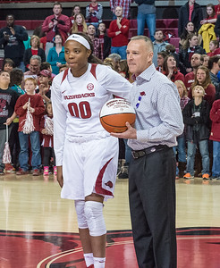 Arkansas Lady Razorbacks forward Jessica Jackson (00) and Arkansas Lady Razorbacks head coach Jimmy Dykes celebrate Jackson's 1000 career points before the start of the  basketball game between Arkansas Razorbacks and Missouri Tigers  on January 17, 2016.    (Alan Jamison, Nate Allen Sports Service)
