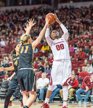 Arkansas Lady Razorbacks forward Jessica Jackson (00) shoots over Missouri Tigers guard Lindsey Cunningham (11) during a basketball game between Arkansas Razorbacks and Missouri Tigers  on January 17, 2016.    (Alan Jamison, Nate Allen Sports Service)