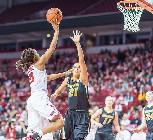 Arkansas Lady Razorbacks guard Devin Cosper (21) shoots over Missouri Tigers forward Cierra Porter (21) during a basketball game between Arkansas Razorbacks and Missouri Tigers  on January 17, 2016.    (Alan Jamison, Nate Allen Sports Service)