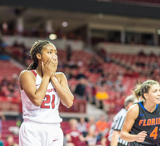 Arkansas Lady Razorbacks guard Devin Cosper (21) reacts to a called offensive foul during a basketball game between Arkansas Razorbacks and Florida Gators  on January 28, 2016.    (Alan Jamison, Nate Allen Sports Service)