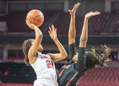 Arkansas Lady Razorbacks guard Devin Cosper (21) shoots during a basketball game between Arkansas Razorbacks and Florida Gators  on January 28, 2016.    (Alan Jamison, Nate Allen Sports Service)