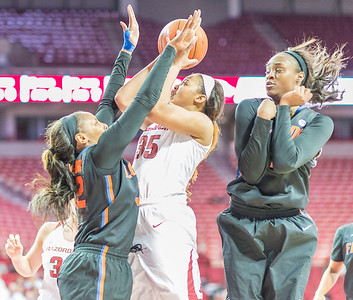 Arkansas Lady Razorbacks center Alecia Cooley (35) shoots under pressure during a basketball game between Arkansas Razorbacks and Florida Gators  on January 28, 2016.    (Alan Jamison, Nate Allen Sports Service)