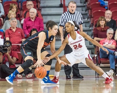 Arkansas Lady Razorbacks guard Jordan Danberry (24) steals the ball from Florida Gators guard/forward Eleanna Christinaki (21) during a basketball game between Arkansas Razorbacks and Florida Gators  on January 28, 2016.    (Alan Jamison, Nate Allen Sports Service)