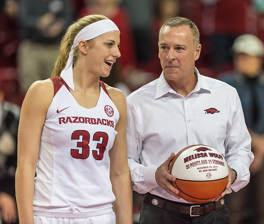 Arkansas Lady Razorbacks head coach Jimmy Dykes presents a basketball to Melissa Wolff in celebration of her 20 points and 20 rebounds on December 30, 2015 against New Orleans - before the basketball game between Arkansas Lady Razorbacks and Mississippi State Lady Bulldogs  on January 31, 2016.    (Alan Jamison, Nate Allen Sports Service)