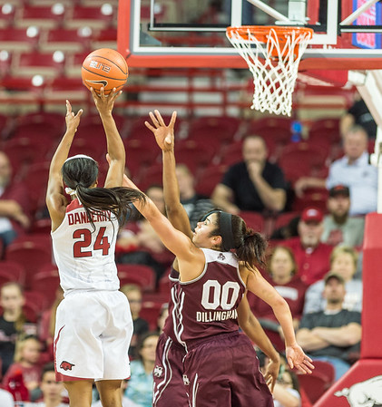 Arkansas Lady Razorbacks guard Jordan Danberry (24) shoots over Mississippi State Lady Bulldogs guard Dominique Dillingham (00) during a basketball game between Arkansas Lady Razorbacks and Mississippi State Lady Bulldogs  on January 31, 2016.    (Alan Jamison, Nate Allen Sports Service)