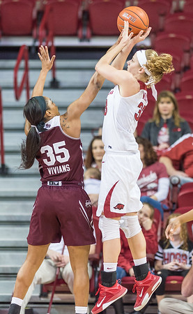 Arkansas Lady Razorbacks forward Melissa Wolff (33) shoots over Mississippi State Lady Bulldogs forward Victoria Vivians (35) during a basketball game between Arkansas Lady Razorbacks and Mississippi State Lady Bulldogs  on January 31, 2016.    (Alan Jamison, Nate Allen Sports Service)