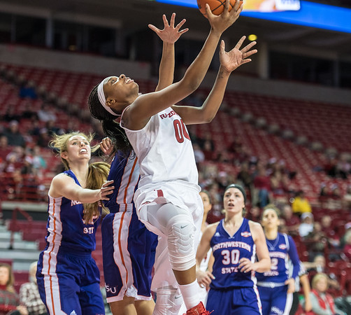 Arkansas Lady Razorbacks forward Jessica Jackson (00) with a reverse layup during a basketball game between Arkansas and Northwestern State on Sunday, December 18, 2016.  (Alan Jamison, Nate Allen Sports Service)