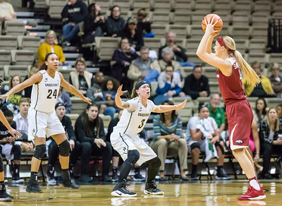 Arkansas Lady Razorbacks guard/forward Keiryn Swenson (4) looks in to pass during a game between the Arkansas Lady Razorbacks and the Vanderbilt Commodores on Sunday, 25 Feb 18, in Nashville TN.  (Alan Jamison, Nate Allen Sports Service)