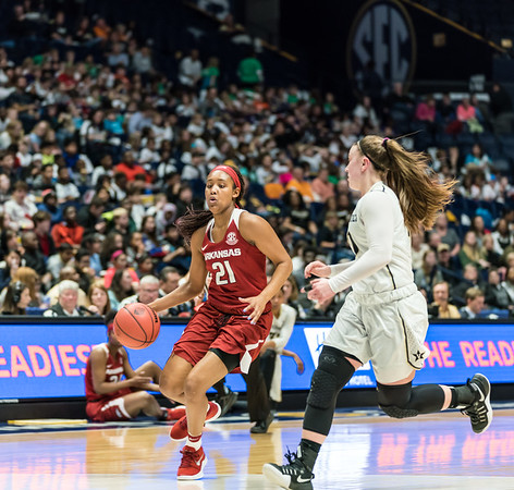 Arkansas Lady Razorbacks guard Devin Cosper (21) drives to the basket during an SEC Tournament game between the Arkansas Lady Razorbacks and the Vanderbilt Commodores on Wednesday, Feb 28, 2018, in Nashville TN.  (Alan Jamison, Nate Allen Sports Service)