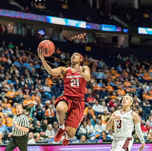 Arkansas Lady Razorbacks guard Devin Cosper (21) lays up a shot during an SEC Tournament game between the Arkansas Lady Razorbacks and the Texas A&M Aggies on Thursday, March 1, 2018, in Nashville TN.  (Alan Jamison, Nate Allen Sports Service)