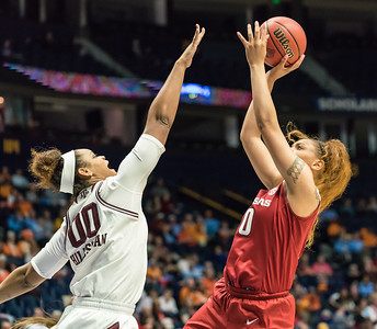 Arkansas Lady Razorbacks forward/center Kiara Williams (10) shoots over Texas A&M Aggies center Khaalia Hillsman (00) during an SEC Tournament game between the Arkansas Lady Razorbacks and the Texas A&M Aggies on Thursday, March 1, 2018, in Nashville TN.  (Alan Jamison, Nate Allen Sports Service)