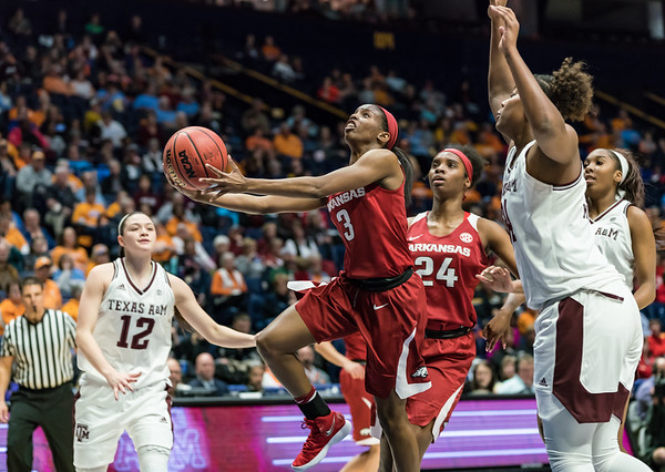 Arkansas Lady Razorbacks guard Malica Monk (3) drives to the basket during an SEC Tournament game between the Arkansas Lady Razorbacks and the Texas A&M Aggies on Thursday, March 1, 2018, in Nashville TN.  (Alan Jamison, Nate Allen Sports Service)