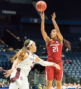 Arkansas Lady Razorbacks guard Devin Cosper (21) shoots during an SEC Tournament game between the Arkansas Lady Razorbacks and the Texas A&M Aggies on Thursday, March 1, 2018, in Nashville TN.  (Alan Jamison, Nate Allen Sports Service)