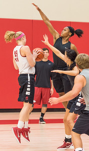 Jordan Danberry goes high on defense at practice during the Women's Basketball Media Day at the new Basketball Performance Center at the University of Arkansas.  (Alan Jamison, Nate Allen Sports Service)