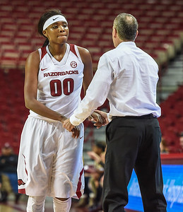 Arkansas head coach Jimmy Dykes congratulates Arkansas Lady Razorbacks forward Jessica Jackson (00) as she exits the game during a basketball game between Arkansas and Oral Roberts on December 10, 2015.    (Alan Jamison, Nate Allen Sports Service)