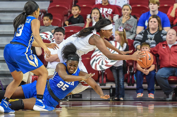 Arkansas Lady Razorbacks forward Jessica Jackson (00) dives for the ball during a basketball game between Arkansas and Tulsa on November 23, 2015.    (Alan Jamison, Nate Allen Sports Service)