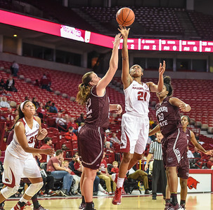 Arkansas Lady Razorbacks guard Devin Cosper (21) shoots during a basketball game between Arkansas and Missouri State on December 2, 2015.    (Alan Jamison, Nate Allen Sports Service)