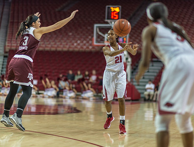 Arkansas Lady Razorbacks guard Devin Cosper (21) passes the ball during a basketball game between Arkansas and Texas A&M on January 7, 2016.    (Alan Jamison, Nate Allen Sports Service)