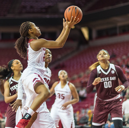 Arkansas Lady Razorbacks guard Devin Cosper (21) shoots during a basketball game between Arkansas and Texas A&M on January 7, 2016.    (Alan Jamison, Nate Allen Sports Service)