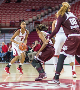Arkansas Lady Razorbacks guard Devin Cosper (21) looks to shoot during a basketball game between Arkansas and Texas A&M on January 7, 2016.    (Alan Jamison, Nate Allen Sports Service)