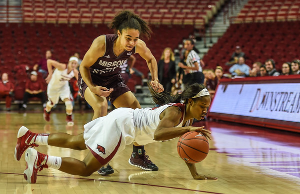 Arkansas Lady Razorbacks guard Jordan Danberry (24) dives for a loose ball during a basketball game between Arkansas and Missouri State on December 2, 2015.    (Alan Jamison, Nate Allen Sports Service)