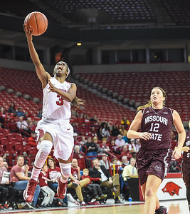 Arkansas Lady Razorbacks guard Malica Monk (3) with a layup during a basketball game between Arkansas and Missouri State on December 2, 2015.    (Alan Jamison, Nate Allen Sports Service)