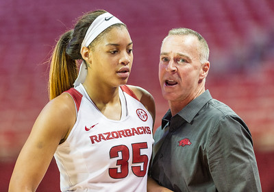 Arkansas Lady Razorbacks head coach Jimmy Dykes  instructs Arkansas Lady Razorbacks center Alecia Cooley (35) during a break in the basketball game between Arkansas and Texas A&M on January 7, 2016.    (Alan Jamison, Nate Allen Sports Service)