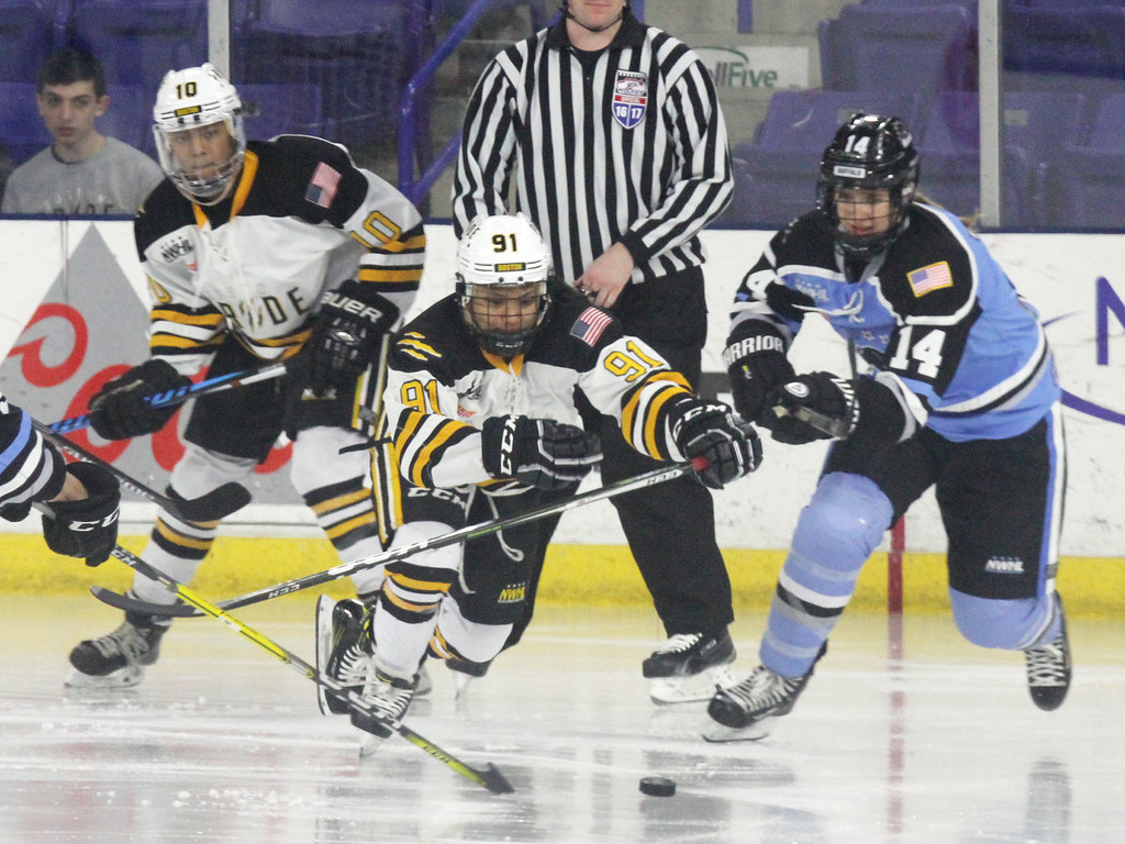 . Boston Pride vs Buffalo Beauts in Isoble Cup final for the National Women\'s Hockey League championship. From left, Pride\'s Blake Bolden (10) and Rachel Llanes (91) and Beauts\' Hayley Scamurra (14). (SUN/Julia Malakie)