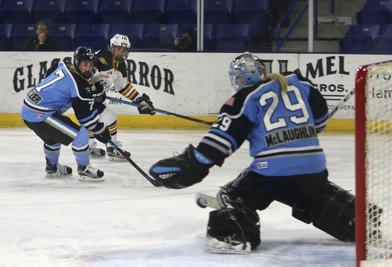 Boston Pride vs Buffalo Beauts in Isoble Cup final for the National Women's Hockey League championship. Beauts' Emily Pfalzer (7) and Pride's Emily Field (15) watch as Beauts' goalie Brianne McLaughlin deflects a shot. (SUN/Julia Malakie)