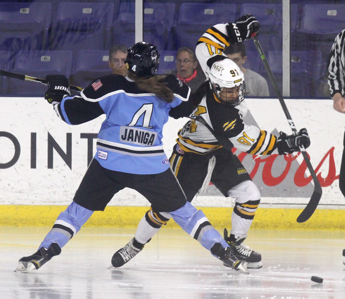 Boston Pride vs Buffalo Beauts in Isoble Cup final for the National Women's Hockey League.  Beauts' Emily Janiga (4) and Pride's Rachel Llanes (91). (SUN/Julia Malakie)