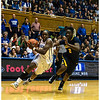 Duke's Chelsea Grey drives by Afure Jemerigbe<br /> Duke vs California Women's Basketball<br /> <br /> Cameron Indoor Stadium<br /> Duke University<br /> Durham, NC <br /> December 2, 2012