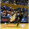 Duke's Chelsea Grey drives by Afure Jemerigbe<br /> Duke vs California Women's Basketball<br /> <br /> Cameron Indoor Stadium<br /> Duke University<br /> Durham, NC <br /> December 2, 2012