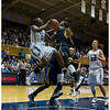 Defended by California's Gennifer Brandon (#25) Duke's Chelsea Grey (12) takes flight while Haley Peters (#33) looks on in horror<br /> <br /> Duke vs California Women's Basketball<br /> <br /> Cameron Indoor Stadium<br /> Duke University<br /> Durham, NC <br /> December 2, 2012