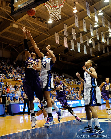 Krystal Thomas (34) and Courney Jones (22) rebounding early in the first half of the Women's NCAA Regional while Allison Hightower (23) and Jasmine Thomas (5) look for opportunities.<br /> <br /> 2010 NCAA Regionals<br /> Cameron Indoor Stadium<br /> Duke University