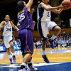 Jasmine Thomas (5) takes aim in the second half of the Women's NCAA Regional Championship.<br /> <br /> Cameron Indoor Stadium<br /> <br /> Duke University<br /> <br /> March 22, 2010