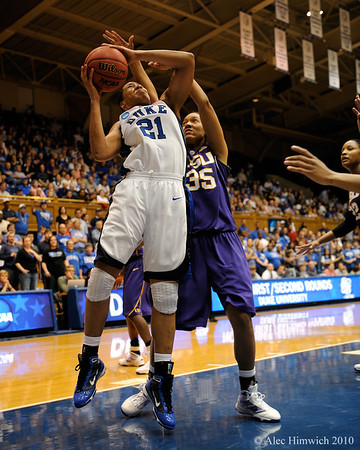 Joy Cheek  (21) shoots against Taylor Turnbow (35) early in the first half of the Women's NCAA Regional Championship.<br /> <br /> Cameron Indoor Stadium<br /> <br /> Duke University<br /> <br /> March 22, 2010