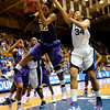Courtney Jones (22) grabs a rebound from Krystal Thomas (34) in the second half of the Women's NCAA Regional Championship.<br /> <br /> Cameron Indoor Stadium<br /> <br /> Duke University<br /> <br /> March 22, 2010