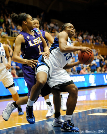Karima Christmas (13) grabs a rebound early in the first half of the Women's NCAA Regional Championship.<br /> <br /> <br /> <br /> Cameron Indoor Stadium<br /> <br /> Duke University<br /> <br /> March 22, 2010