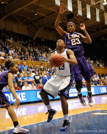 Allison Hightower (23) attempts to block a shot by Karima Christmas (13) in the second half of the Women's NCAA Regional Championship.<br /> <br /> Cameron Indoor Stadium<br /> <br /> Duke University<br /> <br /> March 22, 2010