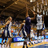 Bridgett Mitchell (15) fouls Destini Hughes early in the first half of the Women's NCAA Regional Championship.<br /> <br /> Cameron Indoor Stadium<br /> <br /> Duke University<br /> <br /> March 22, 2010
