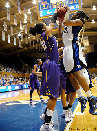 Courtney Jones (22) blocks Karima Christmas (13) in the second first half of the Women's NCAA Regional Championship.<br /> <br /> Cameron Indoor Stadium<br /> <br /> Duke University<br /> <br /> March 22, 2010