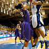 Courtney Jones (22) blocks Karima Christmas (13) in the second first half of the Women's NCAA Regional Championship.<br /> <br /> Cameron Indoor Stadium<br /> <br /> Duke University<br /> <br /> March 22, 2010