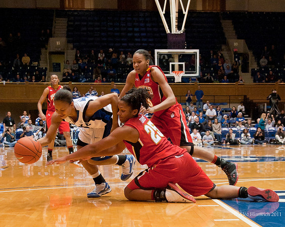 Chloe Well (Duke) grabs the basketball from Allysa Thomas (MD 25)<br /> Cameron Indoor Stadium<br /> Duke University<br /> Durham, NC <br /> January 6, 2011
