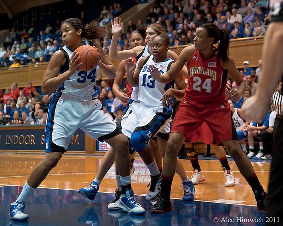 Krystal Thomas (DUke, 34) grabbing a rebound<br /> Cameron Indoor Stadium<br /> Duke University<br /> Durham, NC <br /> January 6, 2011