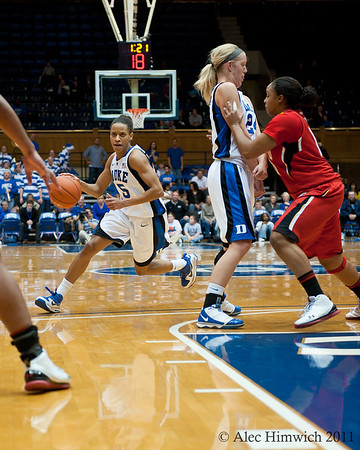 Kathleen Scheer blocks for Jasmine Thomas (Duke, 5).<br /> <br /> Cameron Indoor Stadium<br /> Duke University<br /> Durham, NC <br /> January 6, 2011