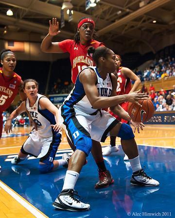 Karima Christmas grabs a rebound<br /> <br /> Cameron Indoor Stadium<br /> Duke University<br /> Durham, NC <br /> January 6, 2011