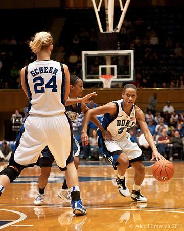 Jasmine Thomas (Duke, 5) using Kathleen Scheer's (DUke, 24) screen<br /> Cameron Indoor Stadium<br /> Duke University<br /> Durham, NC <br /> December 21, 2010