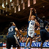 Allison Vernerey (Duke, 43) shoots over Amber Harris (Xavier, 11)<br /> <br /> Cameron Indoor Stadium<br /> Duke University<br /> Durham, NC <br /> December 21, 2010