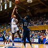 Krystal Thomas (Duke, 34) shoots against Amber Harris (Xavier, 11).  Harris was a dominant player at both ends of the court.  Thomas ended up with 16 points and 6 rebounds, but Harris had 22 points and 15 rebounds. <br /> <br /> Cameron Indoor Stadium<br /> Duke University<br /> Durham, NC <br /> December 21, 2010